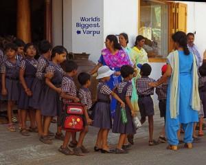 School_children_line_Cochin_Kerala_India